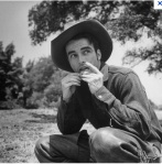 "Montgomery Clift shows the classic cowboy roll on the set of ""Red River."""