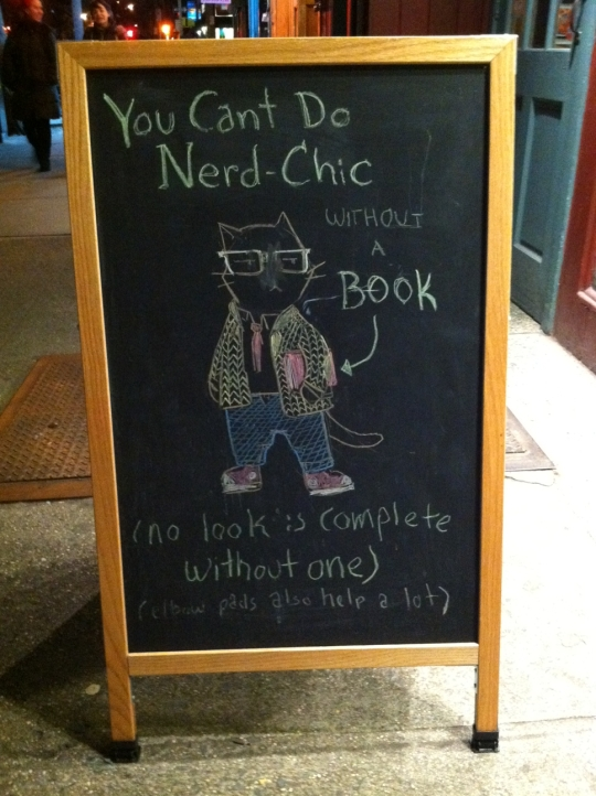 To be a Cool Cat and carry off Nerd Chic, you need a book plus, like, maybe an iPad?