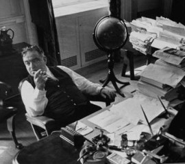 Cigar in hand: Mayor Fiorello LaGuardia in his famously messy office.