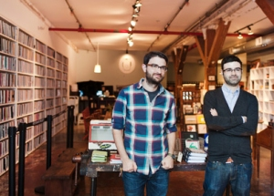 Art House co-founders Steven Peterman and Shane Zucker, at the Brooklyn Art Library. (photograph, Blue Window Creative)