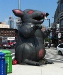 The inflatable critter now marks the corner by the new greenmarket.