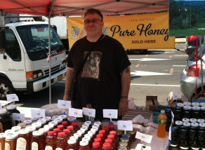 Matt stood ready to explain Applestate Hilltop Family Farm's  varieties of pure honeys