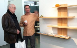 Talking shop with a potential client, Cambium Studio's founder Mark Righter, with coffee, is next to his shelves with sliding dovetails. (Brooklyn Artisan Photo Pool/ams)