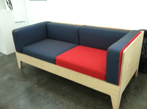 The laminate frame holds the cushions in place; upholstery fits cushions closely.