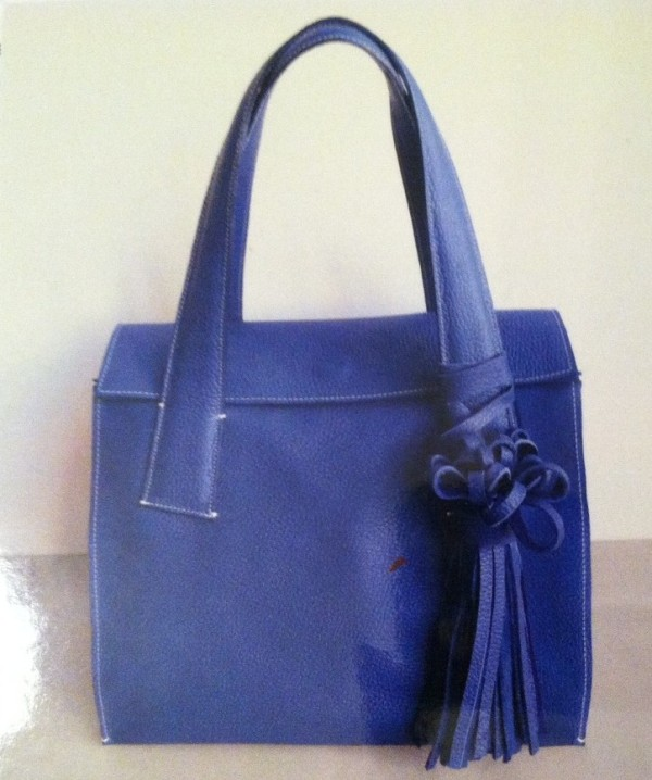 Cobalt blue bag is soft and chic.